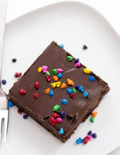 Copycat Cosmic Brownies topped with a Chocolate Ganache and rainbow sprinkles! Super chocolatey, rich and chewy! Just like your childhood favorite.