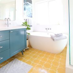 Check out our gorgeous new master bathroom with the most beautiful yellow tile from Fireclay Tile.