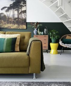 my scandinavian home: A Dutch home gets a green make-over with a half-painted wall  #halfpaintedwall #greensofa #midcentury