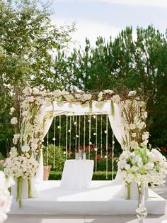 Trellis Wedding Arches: The arch or huppah is a focal point of any ceremony, so make it something to stare at. And there's nothing quite like a flower-covered trellis to do just that. Hanging crystals and cascading vines create a pretty backdrop for photos. Play with color and floral varieties to make it work for any season or setting.