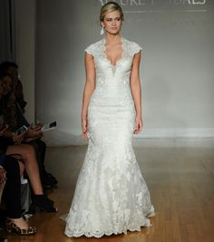 Allure fall 2016 wedding gown with plunging neckline and cap sleeves, sparkling beading and lace all over, fit and flare skirt