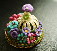 Just looking at this makes my day feel like a blessing.  Felted flower pincushion by  Odile Gova, woolly  fabulous, via Flickr