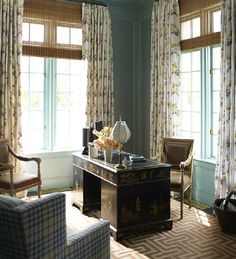 Love the geometric carpet, tall windows, bamboo shades and Tiffany blue wainscoting!