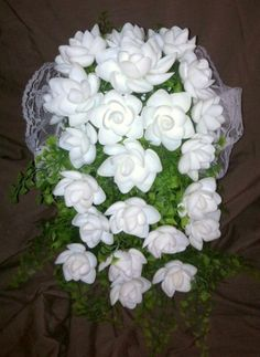 Cascading wedding bouquet made with white cay cay seashells. $89.99 at www.oceanbloomsnow.com