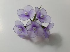Beautiful nylon flowers are greatforhome decorations or party decorations. You can make a handful of these flowers and put them together to make a lovely bouquet.    Materials   nylon fabric pearls soft wires thread scissors round sturdy tube wire cutter green tape