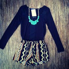 Black long sleeve matched with native print shorts and a bright blue necklace<3
