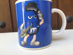 M&M Mars Blue Cup Mug Playing Saxophone  🎷 With Top Hat 🎩  | eBay