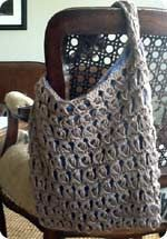 Broomstick Lace crochet handbag pattern - just have to register with wordpress to get access to this free pattern
