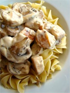 1 lb chicken breast, cut into 1-inch pieces a couple splashes of vegetable oil for cooking 1/2 cup shallots, finely diced 1 lb cremini mushrooms, sliced 1 tsp dried tarragon pinch nutmeg 1 cup sour cream 4 cups cooked broad noodles for serving