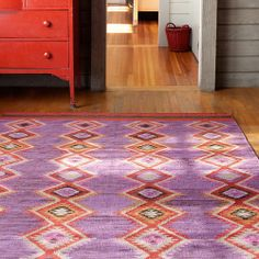 Dash & Albert tribal-inspired diamond design flatweave rug in a bold pink, purple and red colorway via Layla Grayce <3