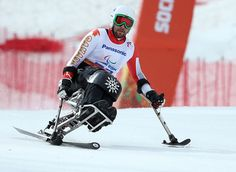 Canadas Josh Dueck survives carnage filled race to win silver in Paralympics sit ski downhill