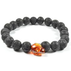A contrast amber Swarovski crystal skull is the focal point of this handsome, unique bracelet. Surrounded by lava rock beads, it's the perfect look for the stylistically bold.
