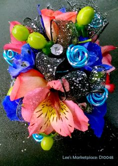 corsage | pink mini roses, blue orchids, pink alstroemeria, green hypericum berries, black sheer sparkle ribbon, twirled turquoise and silver wire with jewel accents