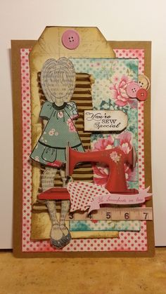 A mixed media doll stamp (prima) Project - with papers from Panduro (sewing bird). Great card idea for sewing teacher