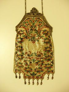 signed Mandalian antique enamel mesh Art-Deco purse on e-bay $130. I think I have this one as a scrap piece, sure looks great intact!