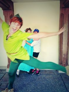 Photobombing level: Peter Pan. I wouldn't even ask for a redo shot. This would suffice.