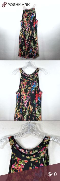 "Betsey Johnson Floral Dress Brand: Betsey Johnson  Description: Sleeveless floral high neck dress which is lined and has a back zipper Size: 12 Material: 100% polyester  Chest Measurement: 19.5"" across laying flat  Length: 37.5"" from shoulder to hem  Condition: Excellent pre-owned condition Betsey Johnson Dresses"