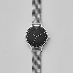 Crystal indexes lend subtle shine to the Anita watch, with numbers marking the 12 and 6 o'clock hours. The 30mm case is finished with a narrow steel-mesh strap.