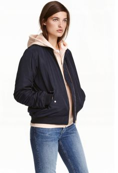 Lightly padded, slightly longer bomber jacket in a generous fit. Zip at front, front pockets with flap, and sleeve pocket with zip. Long Bomber Jacket, Jackets For Women, Clothes For Women, Ladies Jackets, Stylish Coat, Outerwear Women, Stylish Dresses, New Outfits, Fashion Online