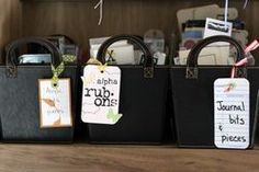 Other things that don't quite fit neatly on shelves, I use totes to store the items.  Some a big, some small.  I also want to see right away what is actually in my totes, so I used scraps of paper & other items to create hanging tags to label everything.