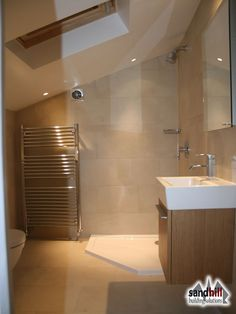 Another, very chic, bathroom layout - but with the shower on a full height wall rather than under the eaves. Toilet under sloping roof instead, which seems a good use of space.