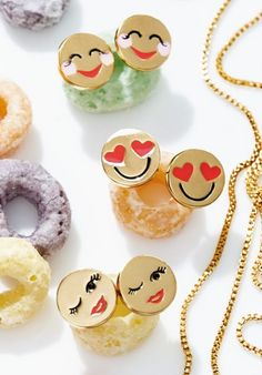 Subtly express the mood of the day with these clever Kate Spade emoji earrings.