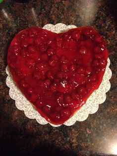 Cherry topped heart shaped cheesecake