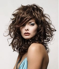 A long brown curly wavy messy hairstyle by Royston Blythe