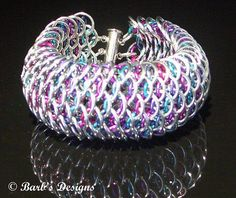 chainmaille dragonscale bracelet...love the colors peeking through! - Berry Awesome Chainmaille Bracelet    This intricate bracelet has over 400 separate rings making up the beautiful Chainmaille pattern. Each ring is opened by me and woven into the bracelet then closed, by me. They are made with bright aluminum rings and colored anodized aluminum rings..