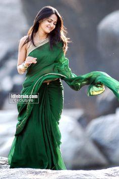 Anushka in bottle green saree