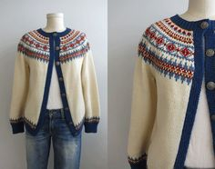 This charming vintage Norwegian fair isle cardigan will never go out of style. Beautifully hand knit in a palette of cream, delft blue and deep red