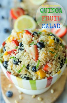 Quinoa Fruit Salad - This protein-packed quinoa salad is brightened up with fresh mango, strawberries and blueberries, balanced with a tart vinaigrette and refreshing mint!