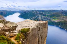 Cliff Preikestolen in fjord Lysefjord, Norway  600 meters above the waters of gorgeous Lysefjord, lay the Preikestolen or Pulpit Rock. It is one of the most breathtaking sites in the country. If you plan to hike it will take almost 2 hours to reach to the spot.