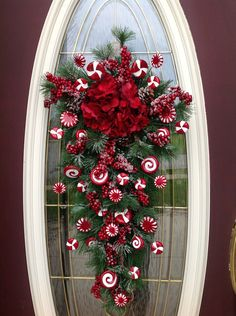 "Christmas Wreath Winter Wreath Vertical Teardrop Door Swag Decor..""Peppermint Candy"". $89.00, via Etsy."