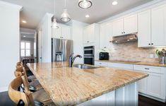Kitchen with kashmir gold granite white cabinets