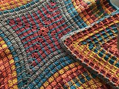 """The Crochet Pandora's Box Blanket by Mikey is an easy to follow pattern that is using the very best of Caron Big Cakes Yarn. Using 4 balls will create square blanket to be about 50"""" square."""
