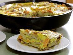 I first learned about tortillas-- the Spanish kind -- on the BBC TV River Cottage series with Hugh Fernley-Whitingshall. You saute and cook various ingredients and then pour whisked eggs overtop. When cooked, the eggs set the whole mixture into a pie -- or a Spanish omelet. This post includes a free video demonstration and a print recipe.    TraditionalCookingSchool.com
