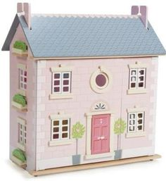 Casa de muñecas de madera estilo inglés en El País de los Juguetes