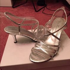Silver Strappy Heels Silver strappy heels, perfect for any formal event! Heel is approximately 2inches (just eyeing it) and still in great condition. Only worn twice, so highly minimal signs of wear (just minor scuffs on the sole and a tiny scuff on each back of the heel as shown). VERY COMFORTABLE shoe for being heeled and still have the box. Lulu Townsend Shoes Heels