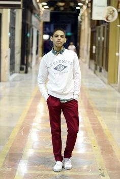 Shop this look on Lookastic:  http://lookastic.com/men/looks/green-shortsleeve-shirt-white-crew-neck-sweater-burgundy-chinos-white-low-top-sneakers/5924  — Green Print Short Sleeve Shirt  — White Print Crew-neck Sweater  — Burgundy Chinos  — White Low Top Sneakers