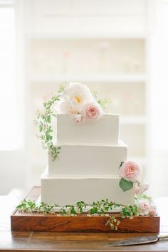 Thinking of adding some pearl cake toppers to this. Then add a few flowers to it.   Modern, square wedding cake (=)