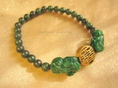 $34.99 Double Delight Dark Green Jade Tiger Pair Bracelet with Carved Tibetan Brass Bead - Feng Shui Energy- Fortune Jade Jewelry by Fortune Jewelry & Healing Beauty, http://www.amazon.com/dp/B00BS3UO9K/ref=cm_sw_r_pi_dp_jNvSrb1EPVJDN