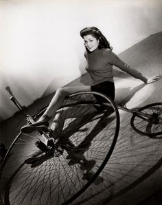 Helen Pender falls off a high wheel bike.Helen Pender The Time the Place the Girl Warner Bros 1946