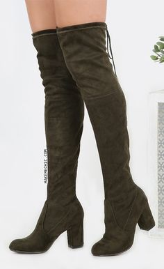 "Drawstring Over the Knee Suede Boots OLIVE. Be the definition of cool in the Drawstring Over the Knee Suede Boots! Features a suede upper, drawstring detail, and an almond toe. Finished with a 3"" chunky heel. Top the look with a t-shirt dress and smokey makeup for a casual but dramatic statement."
