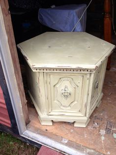 OLD END TABLE GIVEN SHABBY-COTTAGE LOOK FOR UNDER  LOCATED IN BOOTH 22 AT ONCE UPON A TIME IN PENSACOLA FL