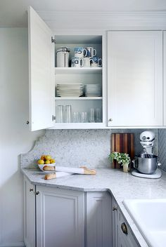 The cabinet/counter addition turned a small and awkward wall space into a functional storage solution and workspace.