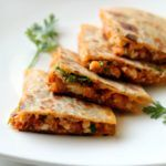 Roti+Pizza makes Rotzza, a super delicious quesadilla style snack to fix those hunger pangs! Super easy to make and a perfect lunchbox item!