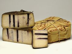 Ubriacone®, a cow's milk cheese bathed in wine and pierced to let the wine further permeate it. From the Veneto, Italy.