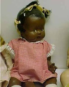 Cute little composition black baby doll....I wonder what year?