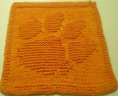 paw dishcloth pattern... Four or five of these right outside the door with a small bowl of water... To wipe off muddy dog paws. ;)
